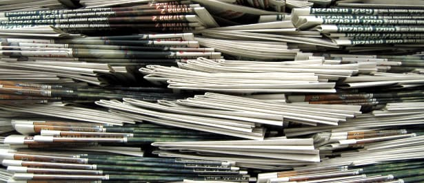 Pila di quotidiani